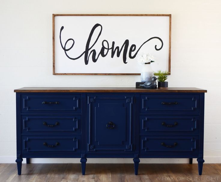 Deep Navy Blue TV Stand converted from an old dresser. The Drawers were removed inside the cabinet to create shelving. Painted in Inked by Behr with a dark walnut stained top | A Ray of Sunlight: Refinished Furniture