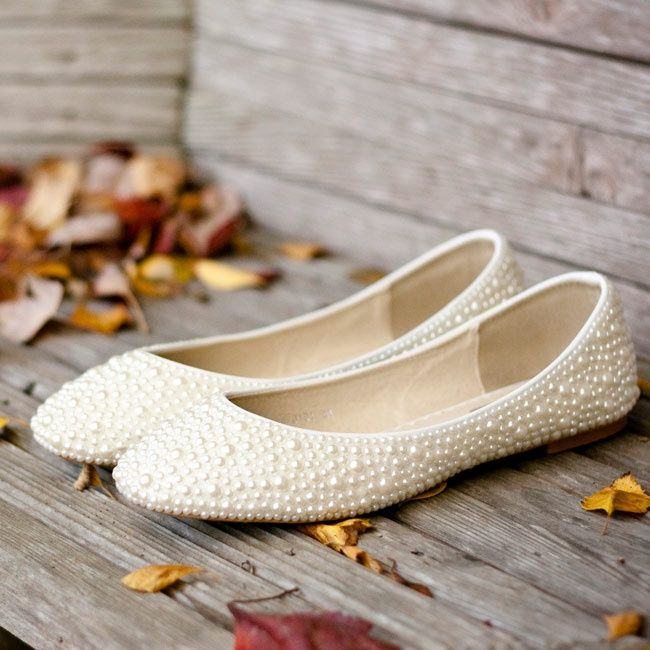 Ivory pearl-studeded bridal flats | Photographer: Jay C. Winter