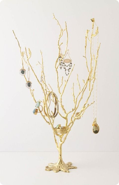 Anthropologie jewelry tree - hmmm...maybe a little paper machete and some gold paint.....