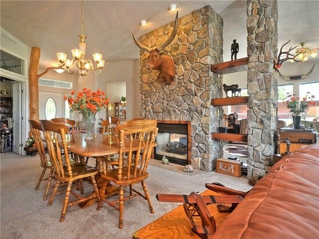 Large Dining room next to entry and office. Huge fireplace creates cozy space.