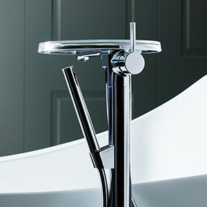 If you're feeling really luxe, the Kartell by Laufen Floorstanding Bath Mixer stands proud in any space with its microphone-style handshower and translucent tray.
