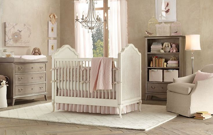 The neutral beige and antique silver work beautifully with soft pink in this delightful baby girl nursery.