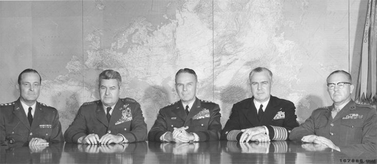 "The Joint Chiefs of Staff During the Final Phases of the Missile Crisis: ""Members of the Joint Chiefs of Staff in session at the Pentagon, Washington, D.C., November 19, 1962. Left to right: General Earle G. Wheeler, Chief of Staff, U.S. Army; General Curtis E. LeMay, Chief of Staff, U.S. Air Force; General Maxwell D. Taylor, USA, Chairman, Joint Chiefs of Staff; Admiral George W. Anderson, Jr. Chief of Naval Operations; and General David. W. Shoup, Commandant, U.S. Marine Corps."""