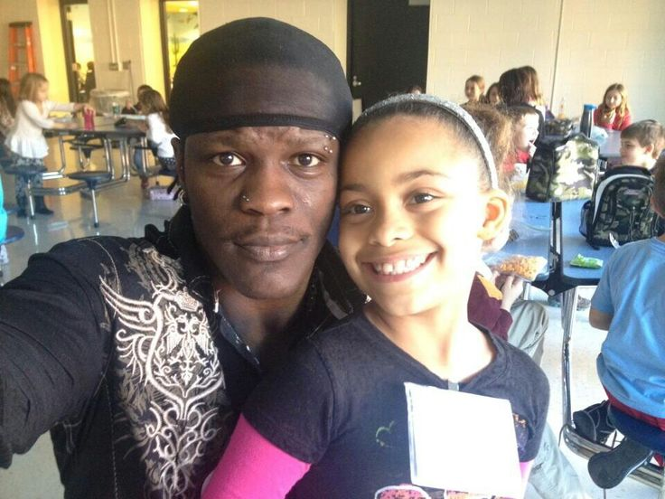 WWE Superstar R-Truth (Ron Killings) and at school with his oldest daughter