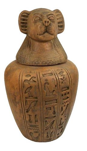Sadigh Gallerys Ancient Egyptian Limestone Canopic Jar Incised onto the front,three rows of hieroglyphs.On the stopper,Thoth (baboon),the God of Wisdom.Canopic jars were used by the ancient egyptians during the mummification process to store and preserve the organs of their owner for the afterlife. 18th dynasty,1570-1085 BC