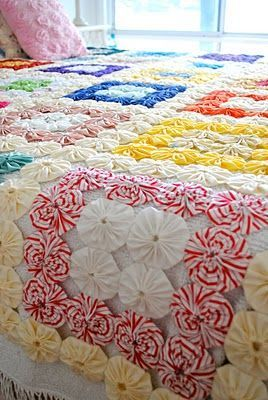 Inspiration for a crochet yo-yo quilt design - (fabric yo-yo quilt - how adorable!!)