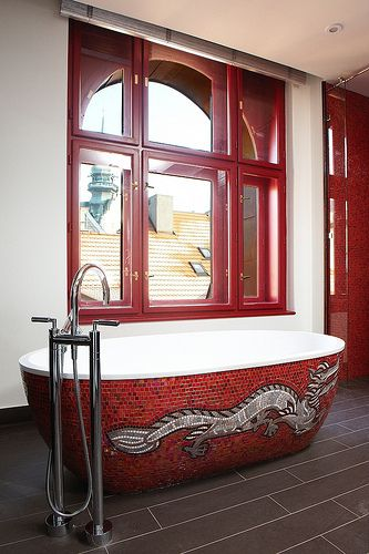 red mosaic bathroom with tiled tub