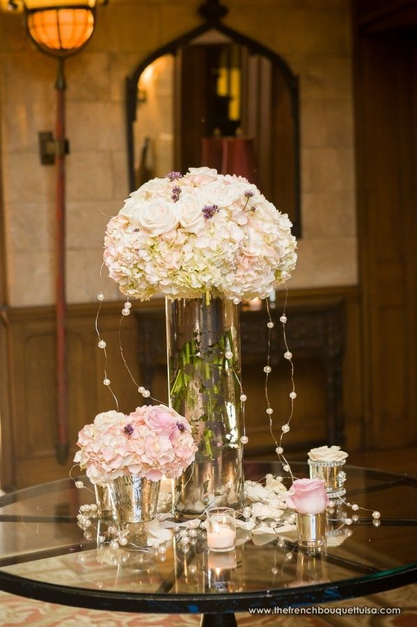 Tall And Low Centerpieces Of Blush And Ivory Hydrangea And