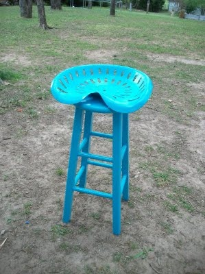 Very simple implementation.  Looks like they used cheap stools from Target or WM and just bolted the seat on top.  I'd worry about stability.