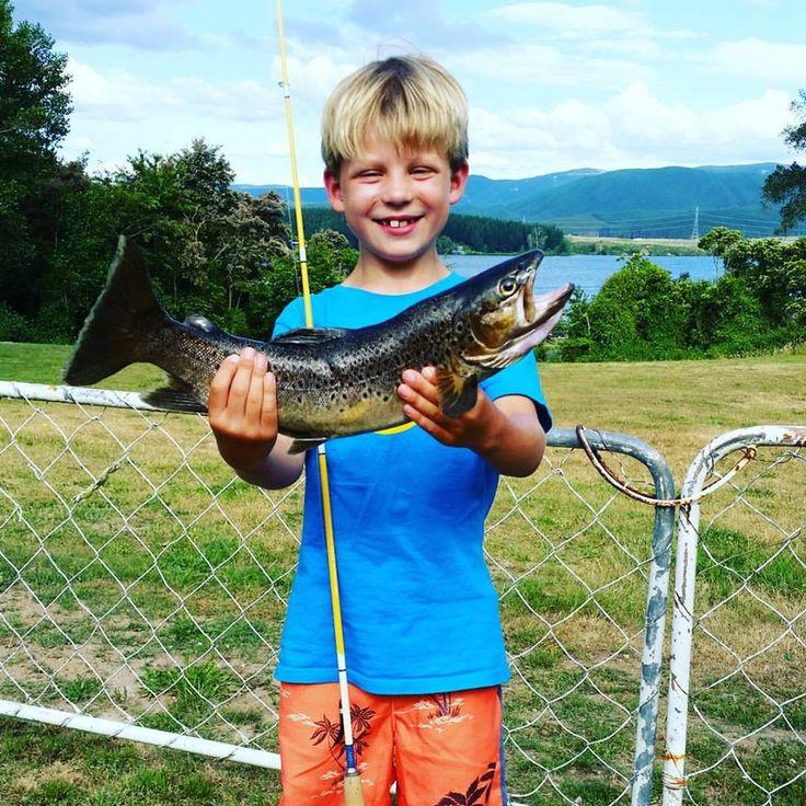 "Sam's first fish - caught on Maven 7'0"" spinning rod. Lake Maraetai, North Island, New Zealand."
