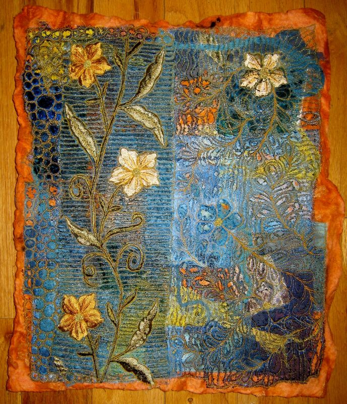 A new piece.  A base of dye painted batting, topped with cotton and silk fabrics, topped with several layers of meltable fabrics.  Heavily machine quilted, scored with a soldering tool and heated with a heat gun.  Great fun! by Heather Thomas