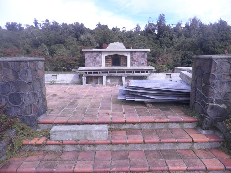 A lone fireplace stands in the rubble of the demolished lodge and awaits the construction of a 1950s style lodge to replace the original building.
