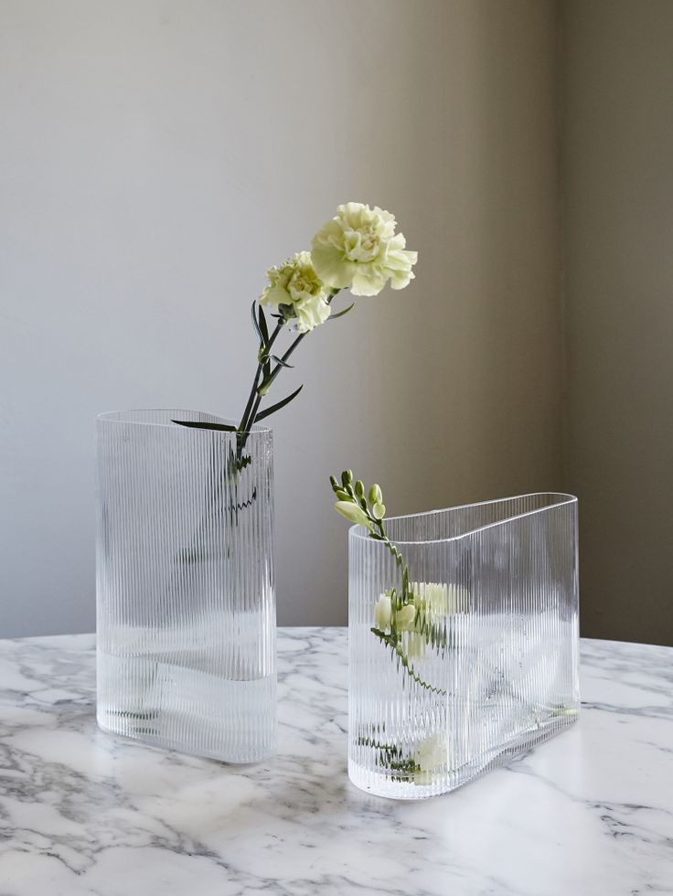 Flower vases made in an extraordinary clear yet corrugated glass. The rippled effect creates an optical illusion reflecting the different colours of the contents in an almost magical way. Available in two sizes.