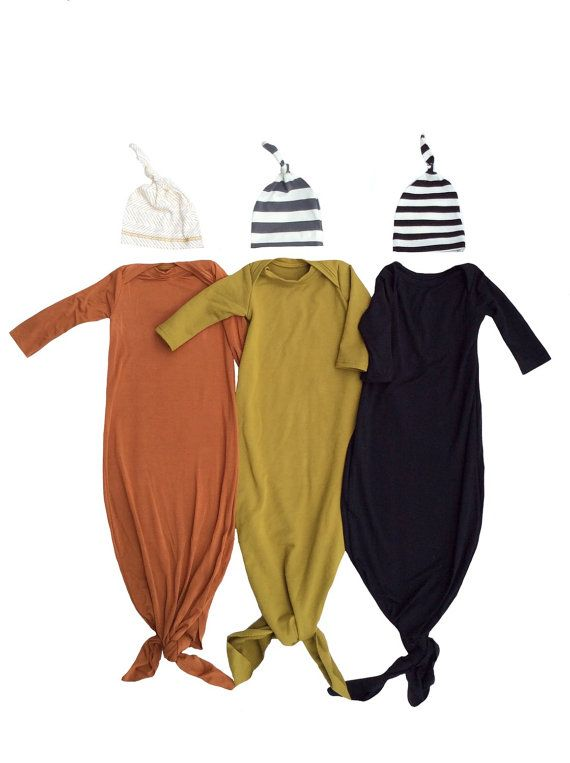 Choose your favorite set!  Knotted newborn gown and hat set, just right for those first weeks.  Spice Orange/herringbone Olive/gray striped Black/Black striped