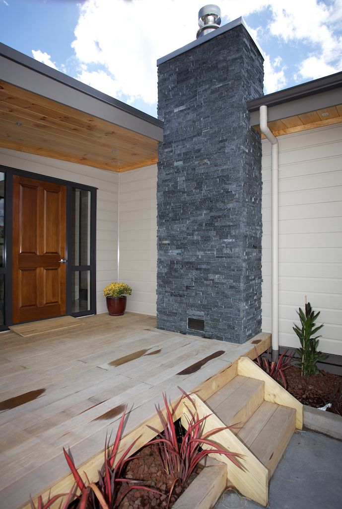 Stone fireplace chimney in Lockwood Kaipara show home In Kumeu, West Auckland