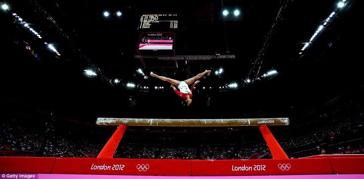 Singapore's Heem Wei Lim performs on the beam in the artistic gymnastics women's team qualification on day two
