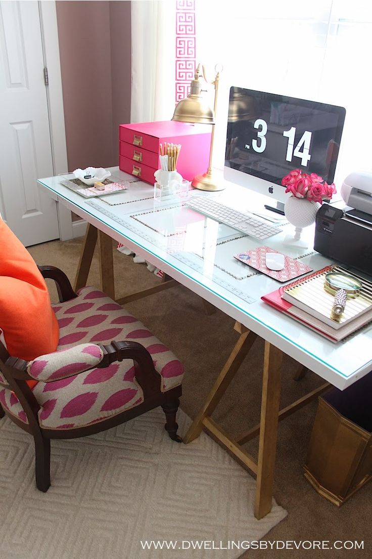 Pretty desk space - pink and gold accessories, glass topped sawhorse desk table.
