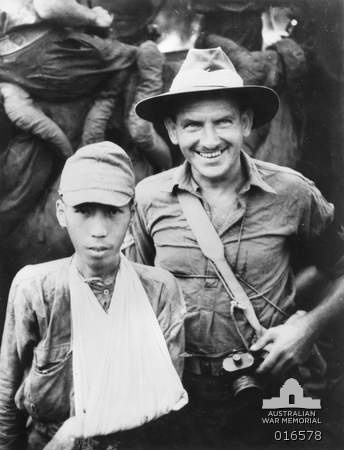 New Guinea. 1944-02-17. A Japanese POW with an Australian guard.