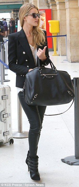 #Travelstyle | Rosie Huntington-Whiteley in a Balmain blazer, Anine Bing skinny pants, Isabel Marant top and ankle booties and a Balenciaga travel bag