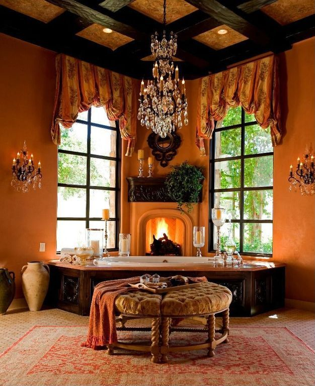 Mediterranean Master Bathroom with Round Ottoman Sectional Coffee Table, Drop-In Bathtub, Wall sconce, Chandelier, Carpet