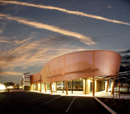Modern Strip Mall With The Sun Setting Retail