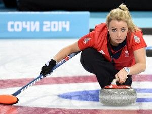 Great Britain's Anna Sloan trows the stone during the 2014 Sochi winter olympics women's curling in her Ice White Turqiose Ice-Watch See this model at: http://www.watcho.co.uk/watches/ice-watch/ice-watch-ice-white-watches/ice-watch-ice-white-turquoise-unisex.html
