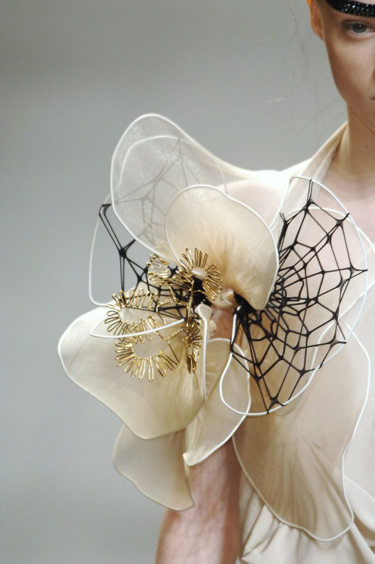 Close up on detail - fashion design 3D floral, spiderweb abstract structure