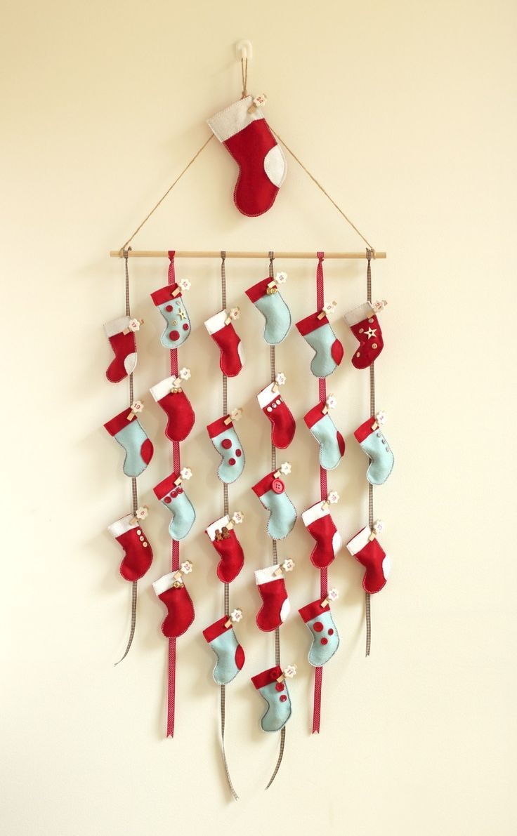 Homemade DIY advent calendar, tutorial has a template for the stockings.  Surprisingly easy to