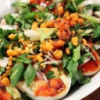 Egg Chaat Flavors of tomato, tamarind and lemon spread on boiled eggs making it a tangy egg chaat.