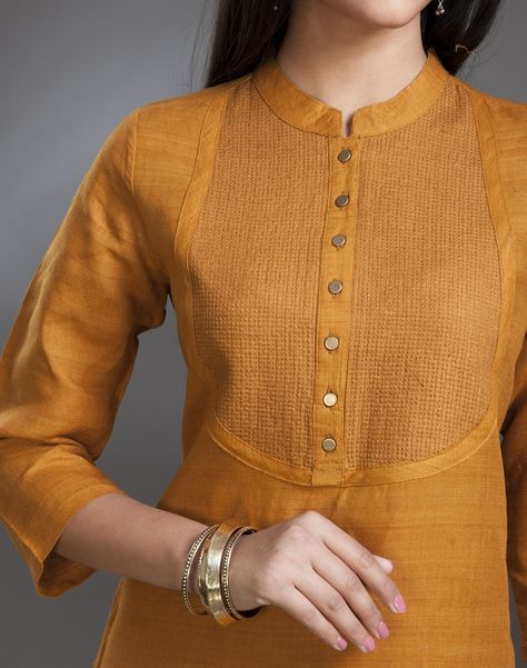 The subtle sheen and rich texture make this elegant silk kurta ideal for festive dressing. This classic kurta features yoke stitch. This kurta can be co-ordinated with vibrant pants, patialas or churidars.  Silk Matka Yoke Stitch Detail Chinese Collar 3Q Sleeves Dry Clean Only