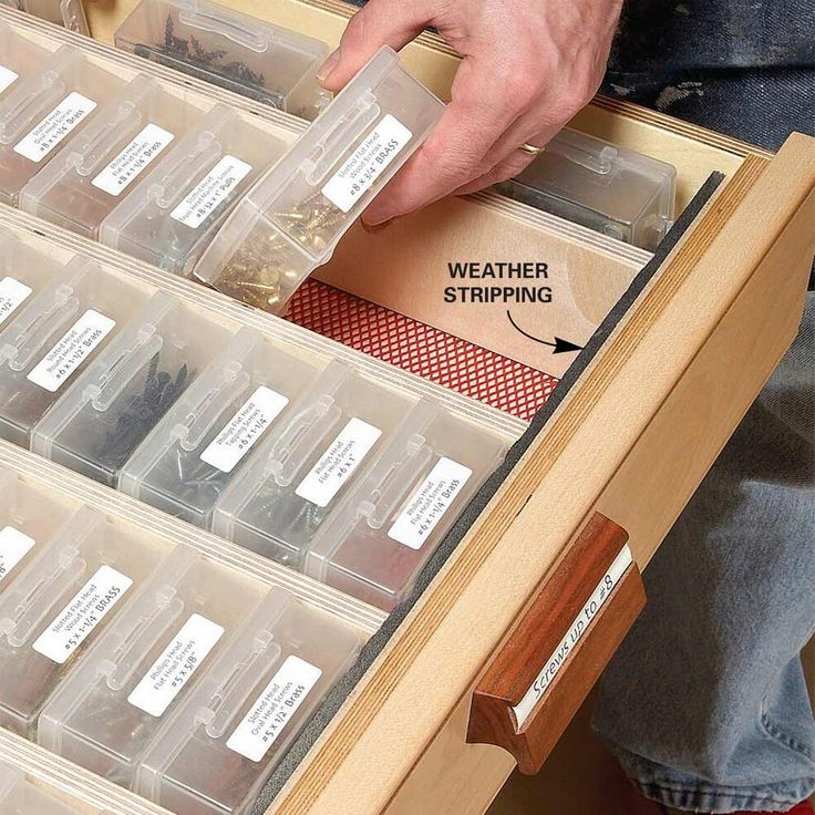 Organized Hardware - In this drawer, movable partitions are held in place by strips of foam weather stripping at the front and back. The 44-plus boxes rest on edge, labels up, for easy grabbing and stowing. The labels are typed on a computer and printed on sticky label sheets. Think of never having to wonder where to find a 1-in. drywall screw or a 3/8-in. washer! Shop for boxes at craft, tackle, office or dollar stores or online.