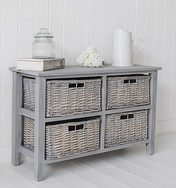 St Ives grey wooden storage furniture low with baskets. Ideas and designs in decorating your white and grey living room from The White Lighthouse www.thewhitelighthousefurniture.co.uk