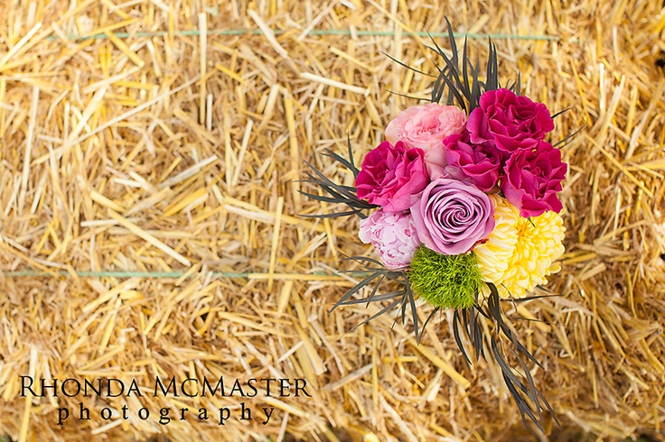 Straw bales with quilts were the seating for the ceremony!  www.theflowerfactory.ca  www.rhondamcmaster.com