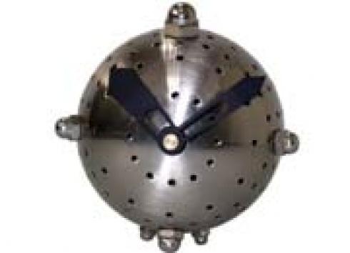 OROLOGIO CAPSULA TAVOLO. Orologio in metallo a forma tonda con piedi a forma di bulloni