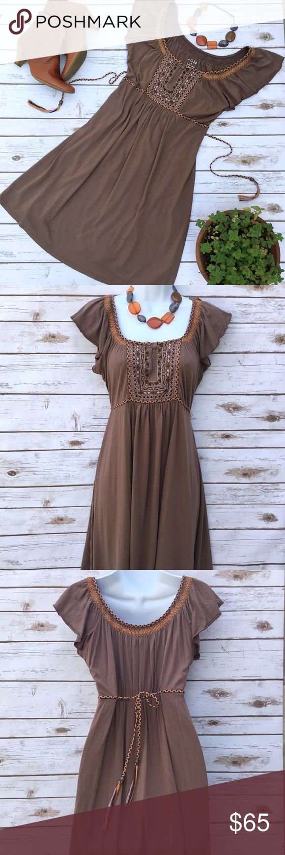 Latin Inspired Embroidered BOHO Festival Dress Lovely brown dress with embroidery along the neckline and in front. Brown and orange braided cord ties in back for a fitted look. 55% cotton and 45% modal. Size M, measures about 17.5 inches across from armpit to armpit and approximately 35 inches in length. Dresses