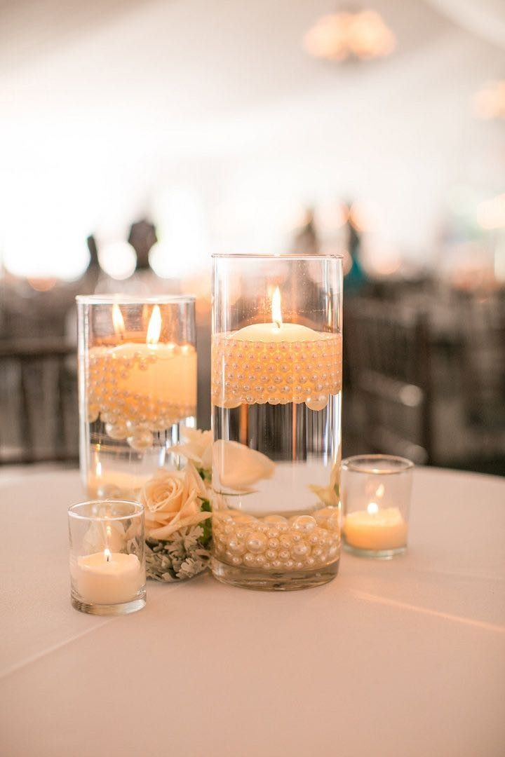 chic wedding centerpiece with candles; Photo: Mike Larson