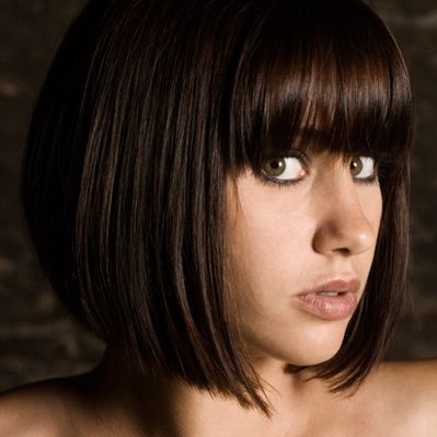 Google Image Result for http://collegecandy.files.wordpress.com/2009/08/woman-with-bangs-copy.jpg