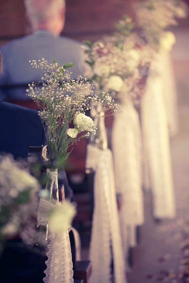 The church isle lined with baby's breath and lace