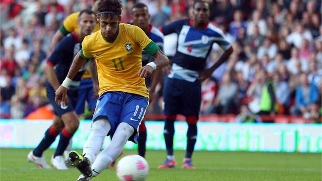 Neymar scores Brazil's second goal during the international friendly match between Team GB and Brazil.