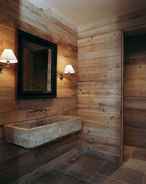 Amazing Rustic Natural Bathroom: Barn walls, multi-sized tile floor, cement sink, wall mounted faucet.