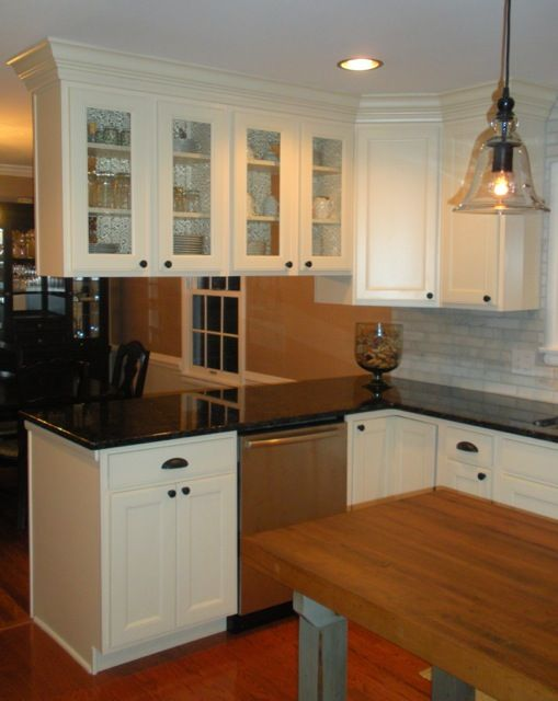 This kitchen remodel features aristokraft maple cabinetry for Hanging kitchen cabinets