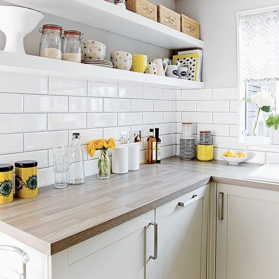 White kitchen with metro tiles and open shelves