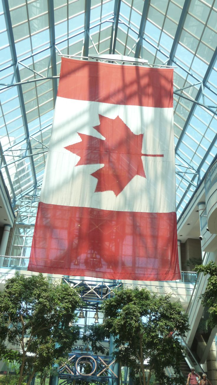Large Canadian flag hangs inside Portage Place mall