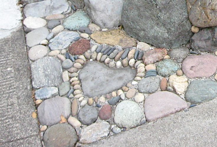 Jeffrey Bale Pebble Mosaic-  Could edge your flower beds with cement and pebbles/rocks