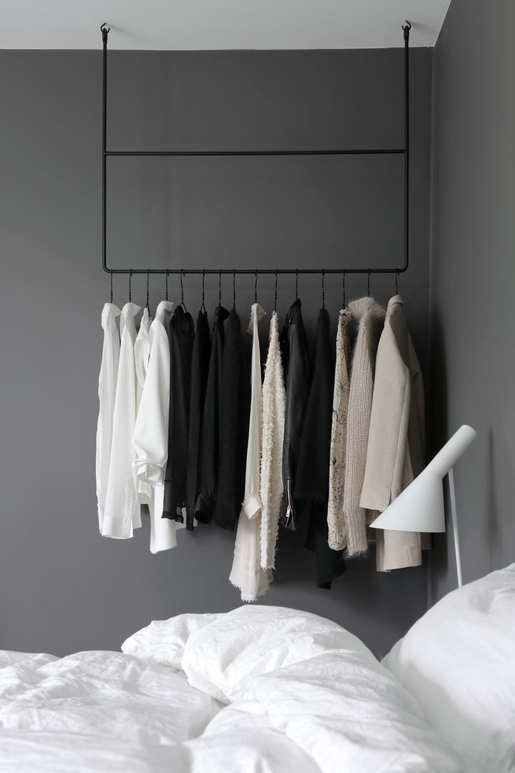 A great laundry room hanger .... arara de roupas no quarto // clothing rail in the bedroom ~ via Stylizimo.
