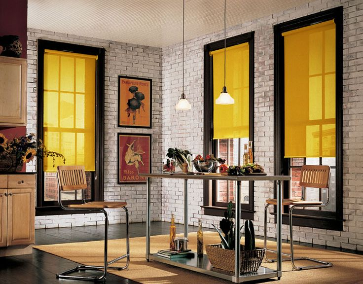 Yellow roller blinds + brick = cool space