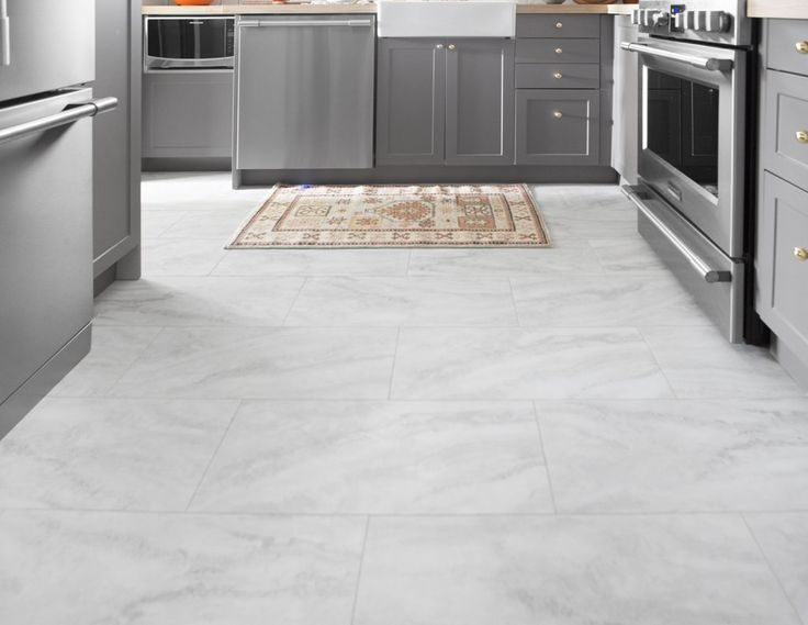 12×24 luxury vinyl tile (LVT) that looks like marble. - Before and After: A Small, Pittsburgh Kitchen Gets A Complete Makeover in 6 Days