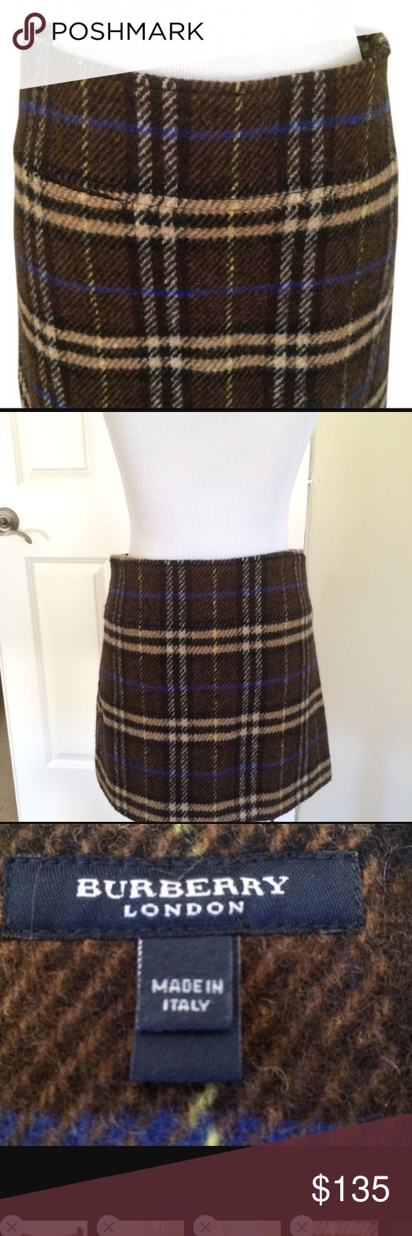 ✨Burberry Plaid Wool Brown Miniskirt, Sz 4✨ Authentic Burberry London Plaid Miniskirt  Size: 4 (US)  Excellent condition!  Worn only twice, so no tags attached  Fabric Content: 100% Lambswool; Lining: 100% Cupro  Fabric Care: Dry clean  Colors Include: Brown, cream, dark brown, and a bit of blue  Item Specifics & Details: Zipper closure at side. Fully lined. Pulls on. Front pockets, which are not obvious and were never used  Super cute and very comfy Burberry Skirts Mini