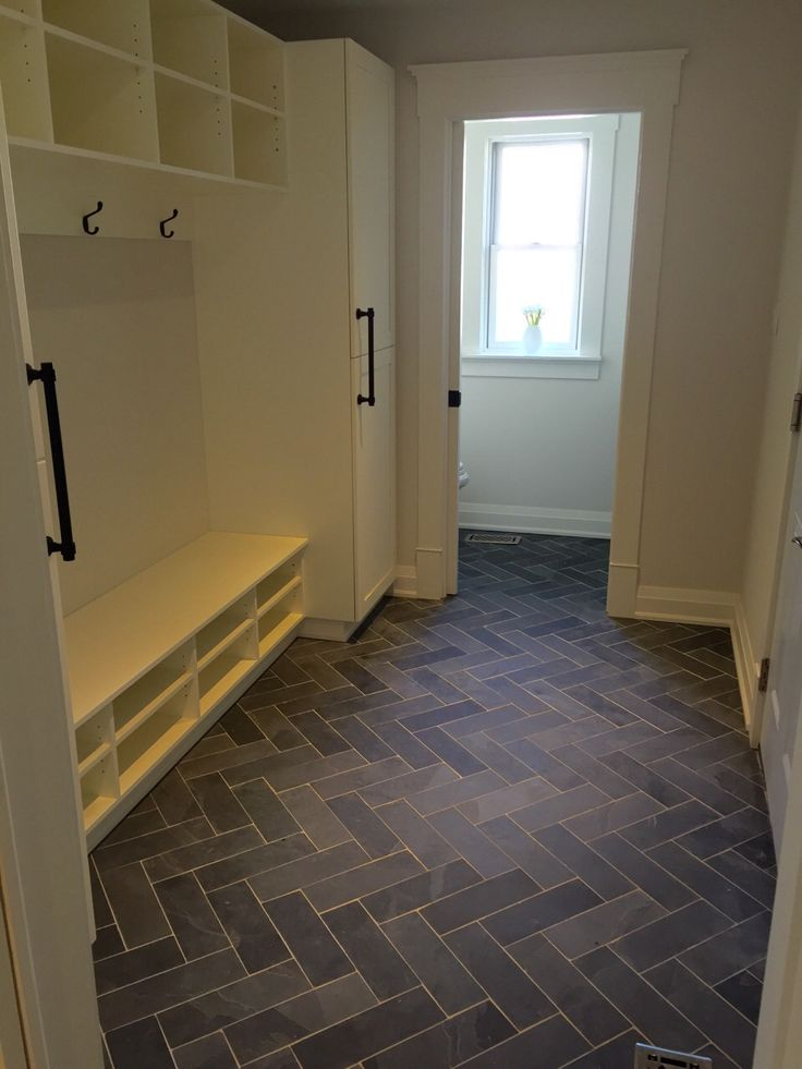 Mudroom / Powder Room flooring. Slate tile done in the Herringbone pattern