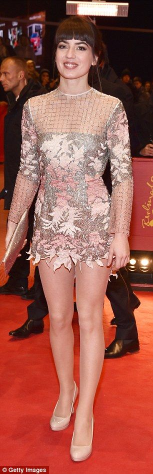 Looking every inch the red carpet queen: She looked trim in the exquisite garment...